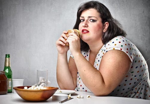 obese woman eating food